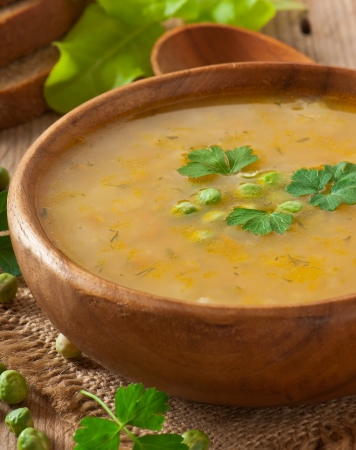 sausage pot: Traditional fresh pea soup in the bowl