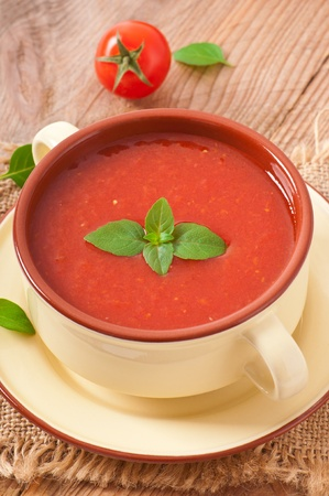 Traditional hot fresh diet tomato soup with basil photo