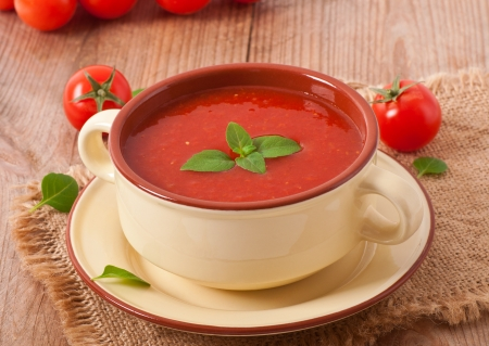 vegetable soup: Traditional hot fresh diet tomato soup with basil Stock Photo