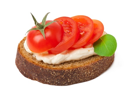 Warm bread tomatoes, cream cheese and basil isolated on white background