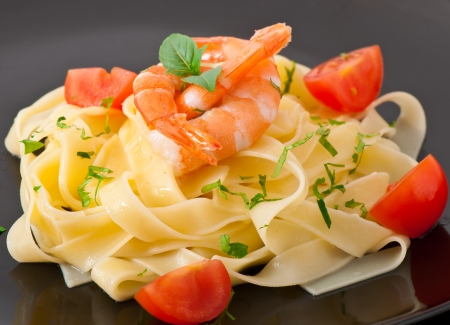pasta with shrimps and tomatoes photo