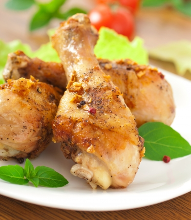 drumsticks: Grilled chicken legs and vegetables