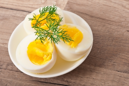 Boiled eggs on white plate photo
