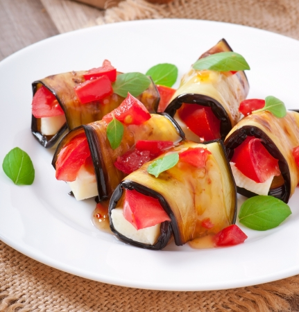 meatless: Eggplant rolls stuffed with cheese with a slice of tomato