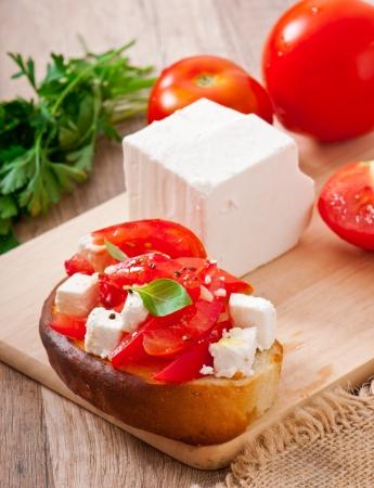 bruschetta with tomato, feta and basil photo
