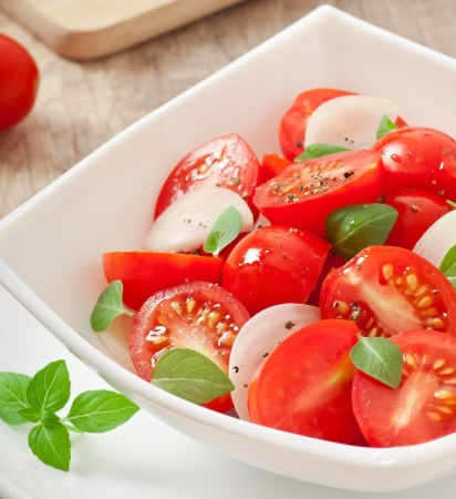 meatless: tomato cherry salad with basil, black pepper and onion