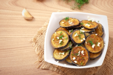 Platter of grilled eggplant with garlic and dill Stock Photo