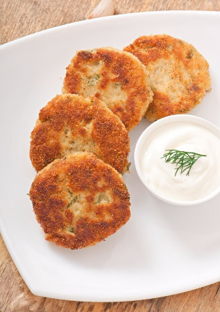 Cutlets cauliflower with fennel, garlic and cheese sauce photo