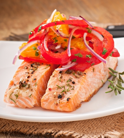 steak dinner: Baked salmon with a salad of sweet peppers and oranges Stock Photo