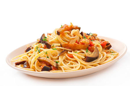 spaghetti with fried eggplant and tomatoes and sweet and sour sauce photo