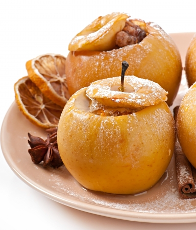 christmas ground: Baked apples with honey and nuts Stock Photo