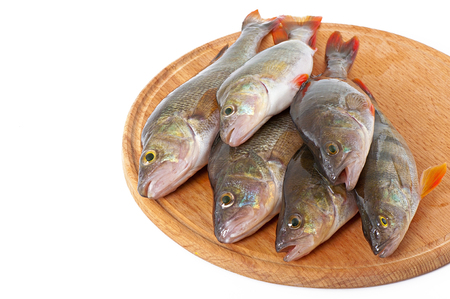 greenling: Raw fish on a cutting board isolated on white background