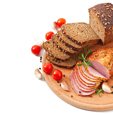 Ham, bread and spices on wooden board  photo