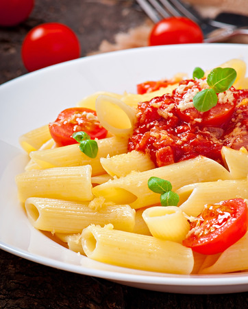 pasta dish: Penne pasta with bolognese sauce, parmesan cheese and basil  Stock Photo