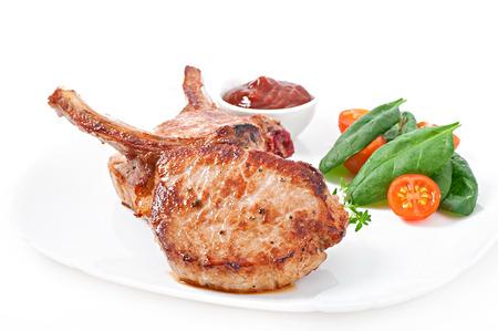 Juicy grilled pork fillet steak with greens photo