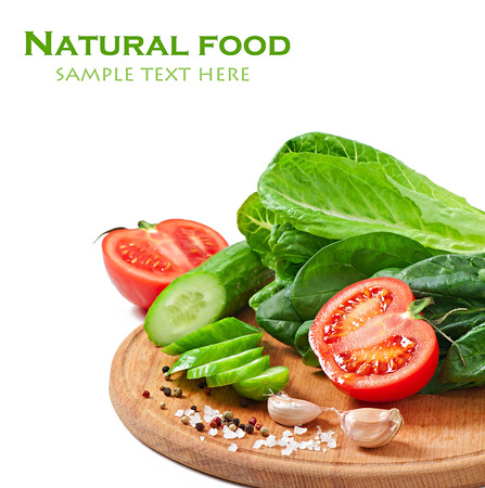 Fresh vegetables on the white background with text photo