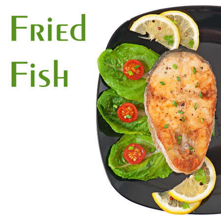 fried fish fillet with vegetables on white background photo