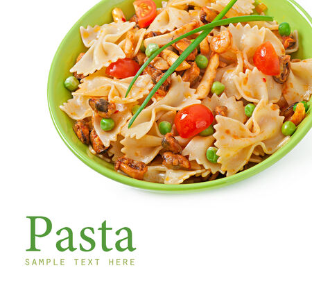 Farfalle pasta with seafood, cherry tomatoes and green peas photo