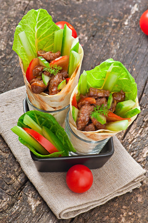 Tortilla wraps with meat and fresh vegetables photo