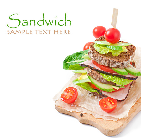 Sandwich with ham and fresh vegetables on white background photo