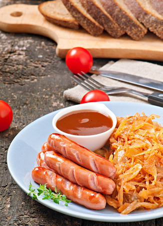 Sausages and fried cabbage photo