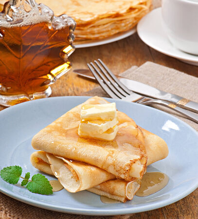 Pancakes with maple syrup photo