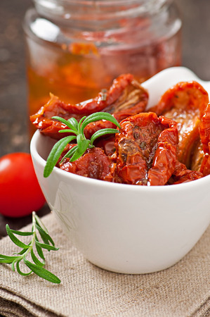 Dried tomatoes and rosemary photo