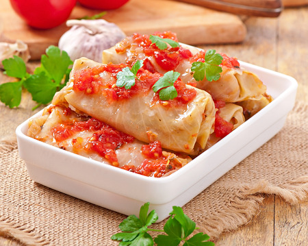 Stuffed cabbage with tomato sauce decorated with parsley photo