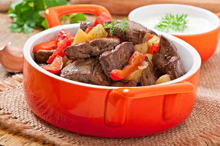 Roast chicken liver with vegetables photo
