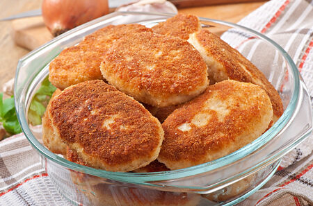 Chicken cutlets in a glass bowl photo