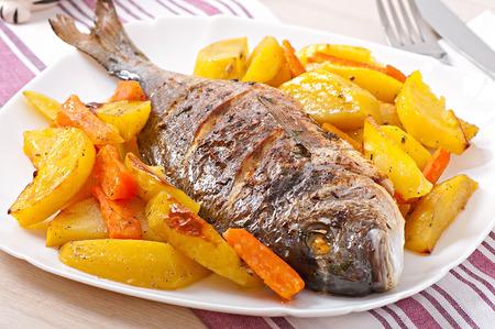 Dorada baked with potatoes photo