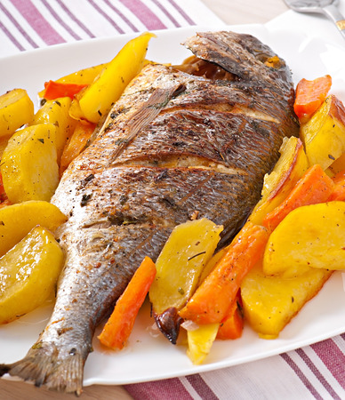 dorada: Dorada baked with potatoes