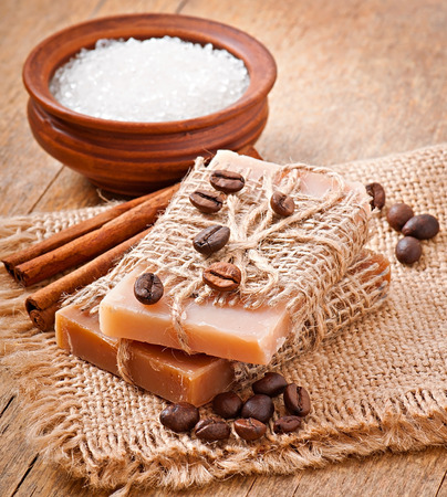 Natural soap on wooden background photo