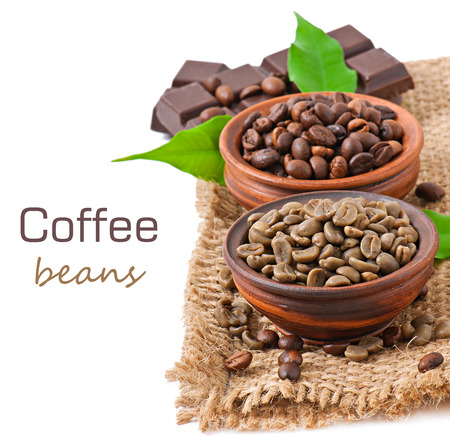 Green and brown coffee beans in bowls photo