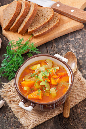 Vegetable soup isolated on white background photo