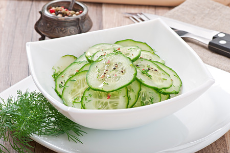 Fresh salad of cucumbers with dill and pepper photo