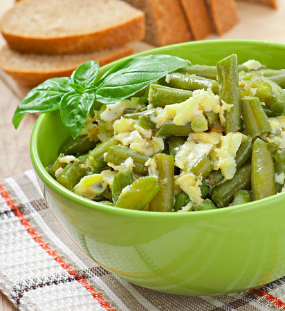 String beans with eggs in bowl  photo