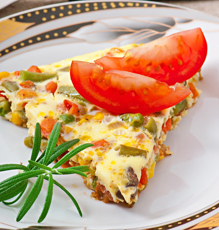 Omelet with vegetables photo