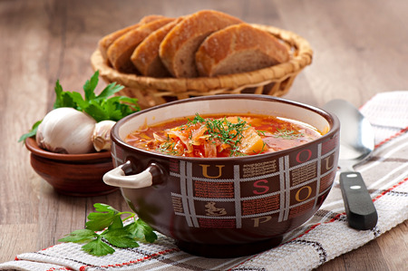Ukrainian and russian national red soup borsch closeup photo