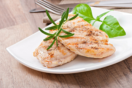 Grilled chicken breasts photo