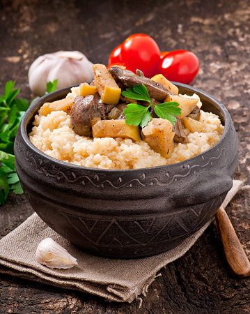 Wheat porridge with liver and apples photo