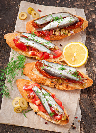 sundried: Crostini with anchovies, olives and sun-dried tomatoes
