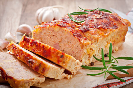 loaf: Homemade ground meatloaf with ketchup and rosemary
