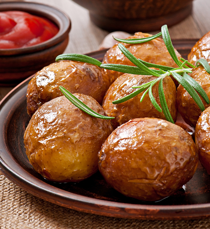 Baked potatoes with rosemary photo