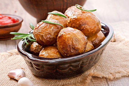 Baked potatoes with rosemary photo