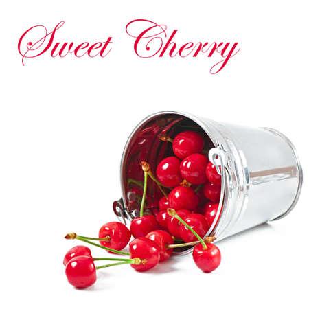 cherries in a metallic bucket isolated on white photo