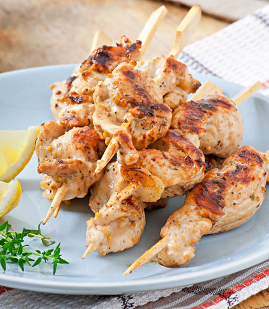 grilled chicken on bamboo skewers photo