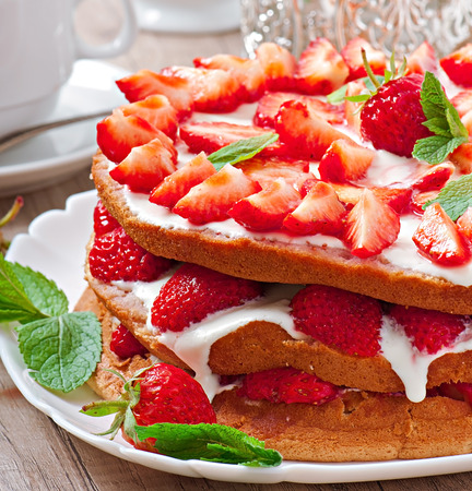 Summer strawberry cake in the form of a rustic photo