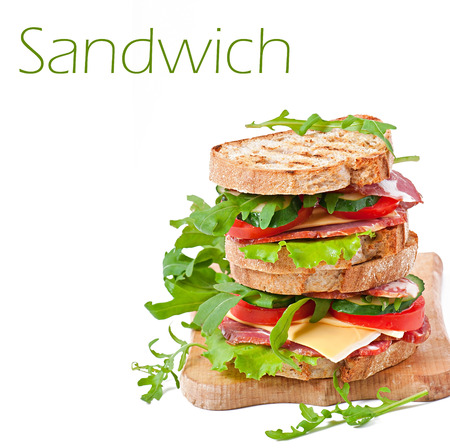 Sandwich with ham, cheese and fresh vegetables on white background photo