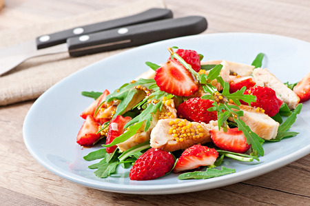 Chicken salad with arugula and strawberries photo